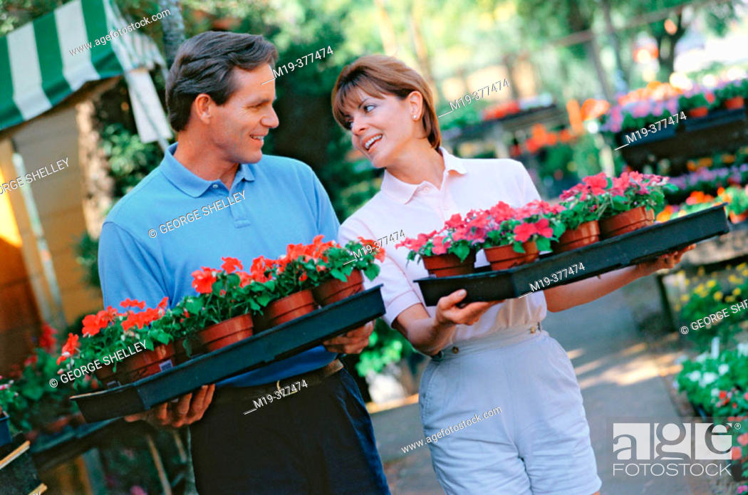 Stock Photo: couple buying flowers for the garden.