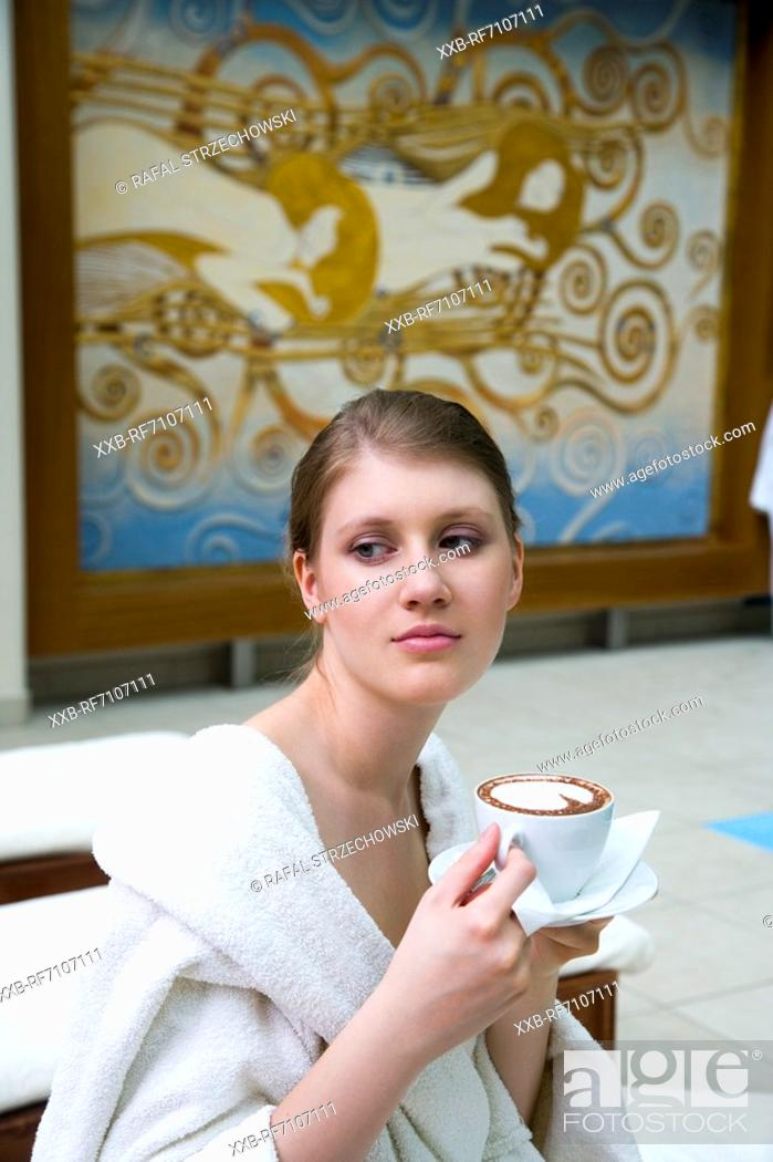 Stock Photo: Young woman with coffee.
