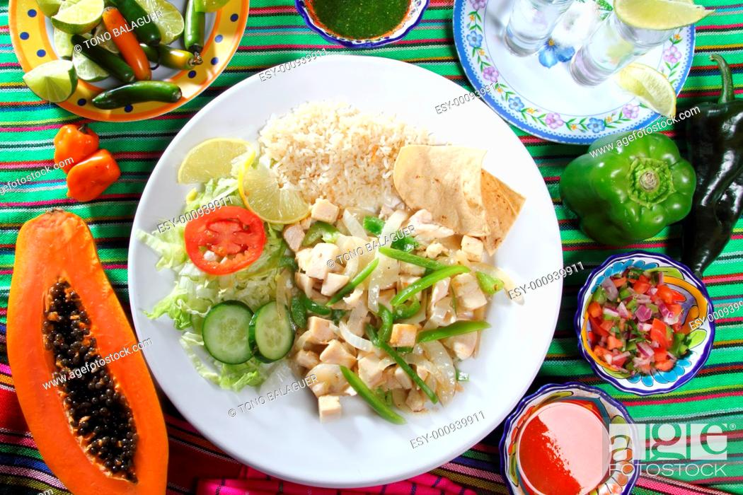 Stock Photo: chicken mojo de ajo garlic sauce mexican chili sauces papaya and tequila.
