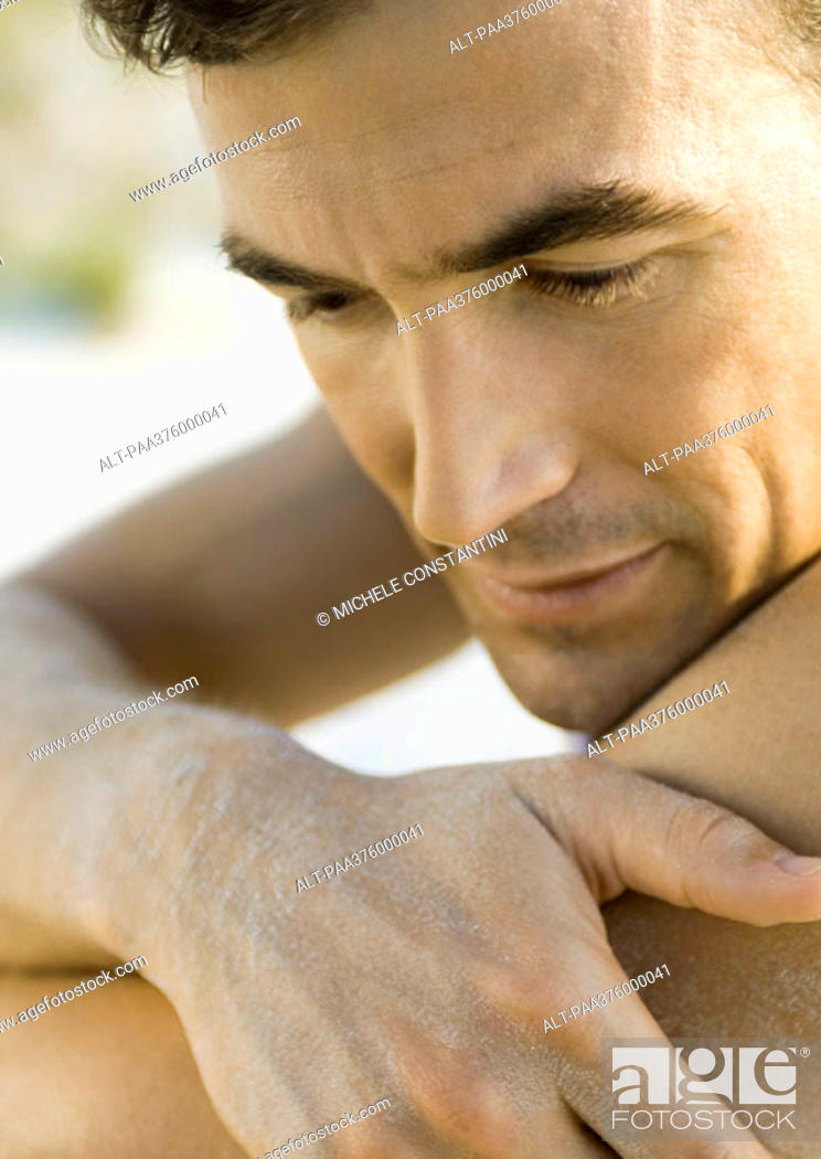 Stock Photo: Man resting face on shoulder, close-up.