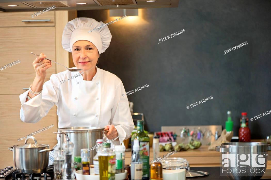 Stock Photo: Woman tasting food.