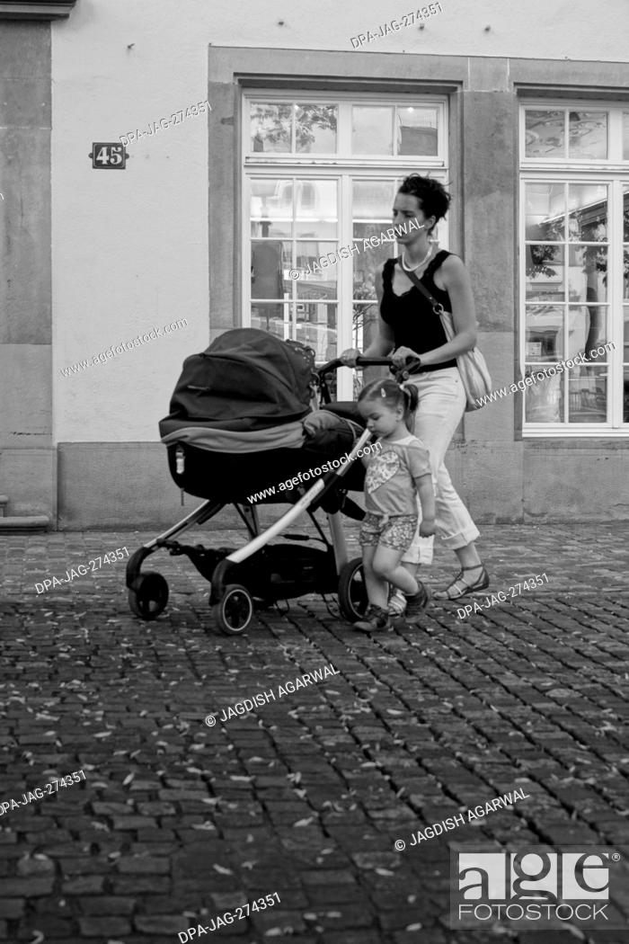 Stock Photo: Woman pushing pram, Zurich, Switzerland, Europe.