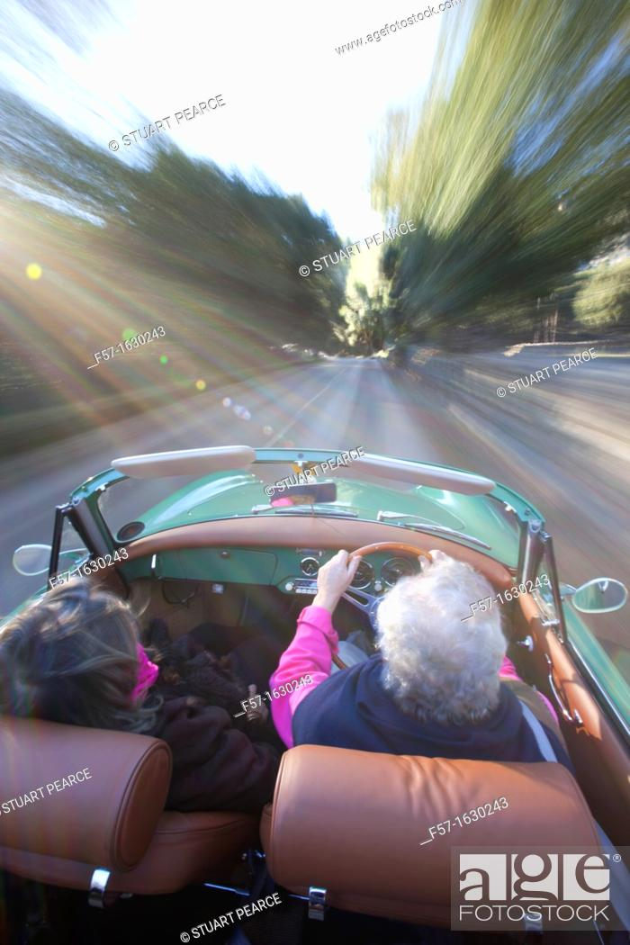 Stock Photo: Retired couple driving their Classic 1959 Porsche 356A Cabriolet.