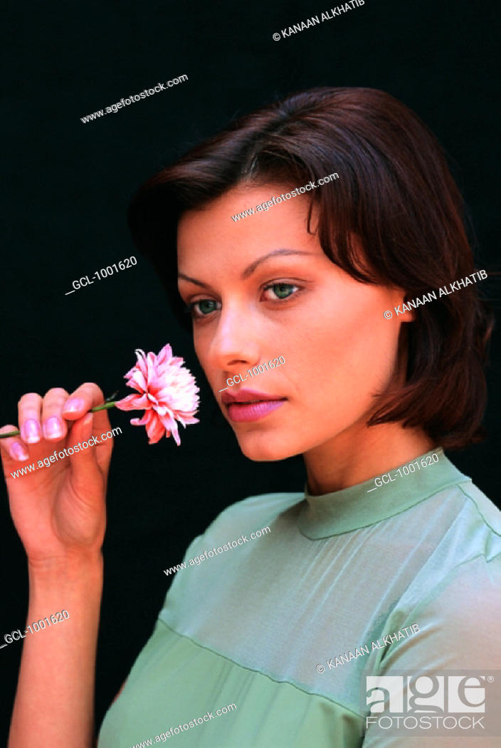 Stock Photo: Woman with flower.