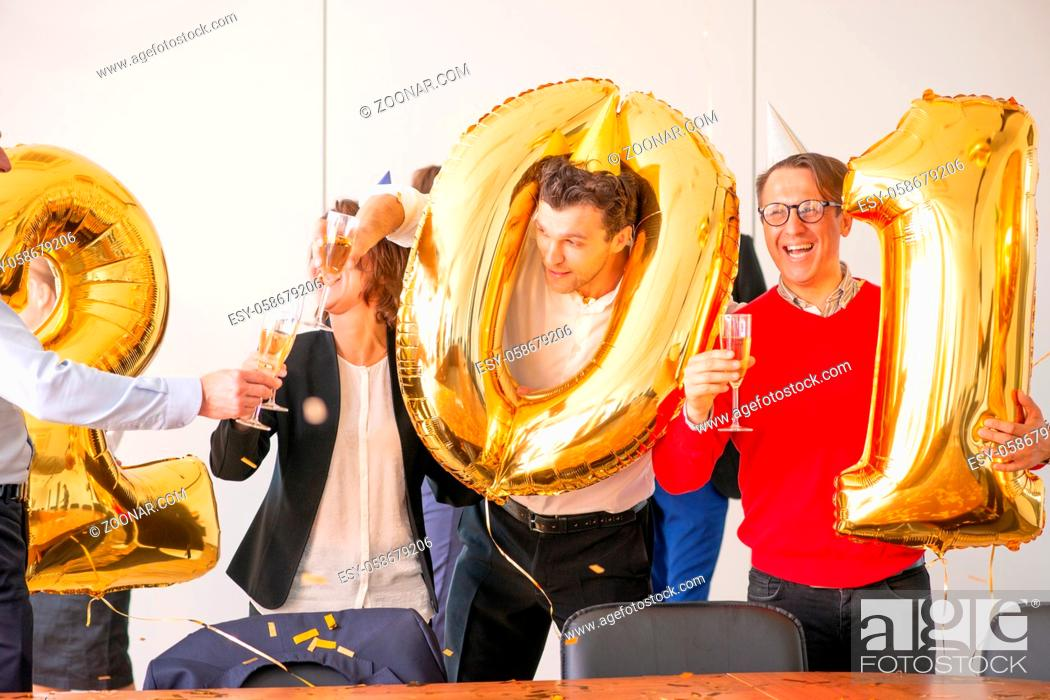 Stock Photo: Business people are celebrating holiday in modern office drinking champagne and having fun in coworking. Merry Christmas and Happy New Year 2020 concept.