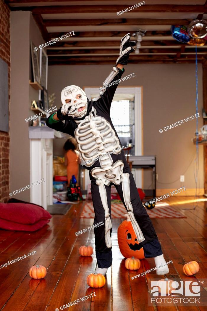Stock Photo: Black boy wearing skeleton Halloween costume.