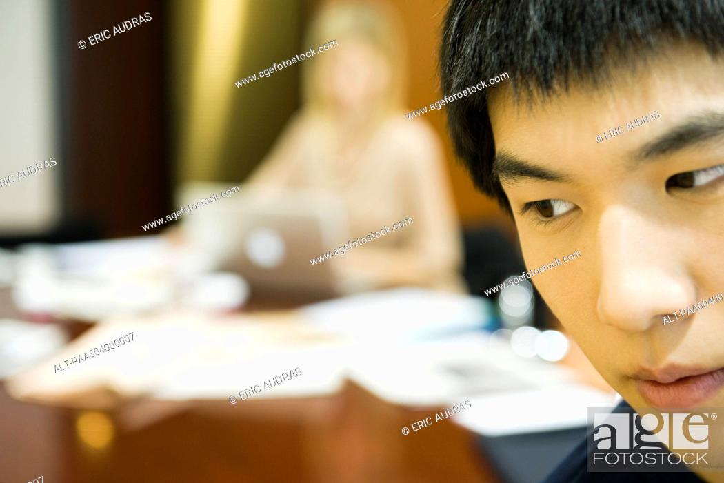 Stock Photo: Young man looking away in thought.
