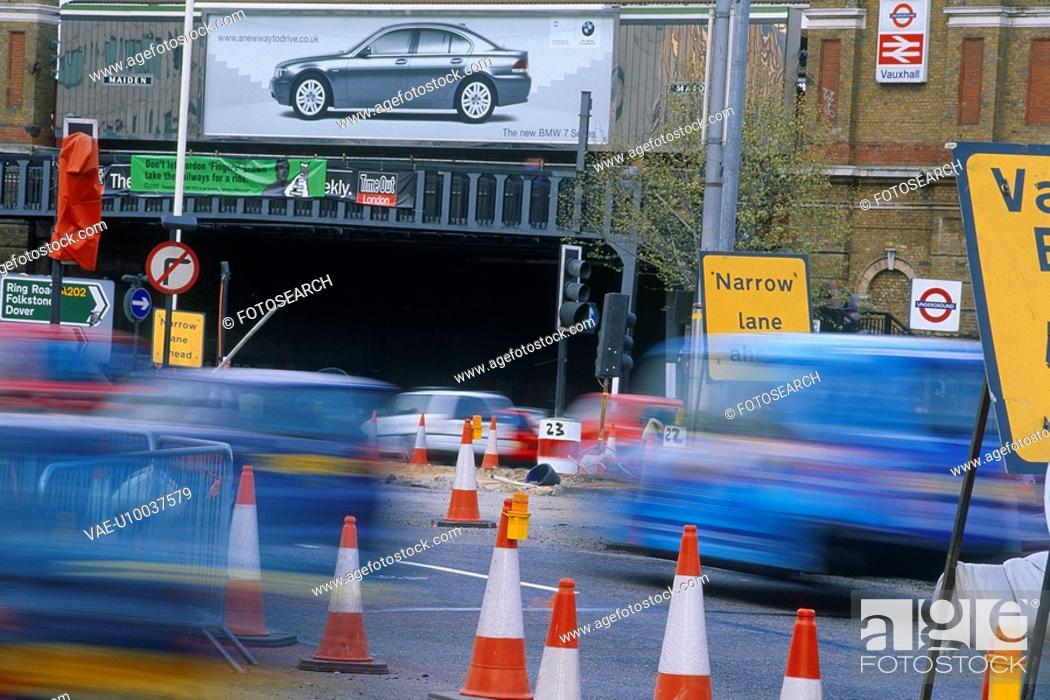 Stock Photo: Vehicles negotiating traffic management.