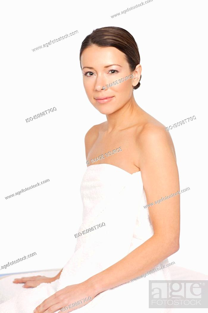 Stock Photo: Young woman wearing towel.