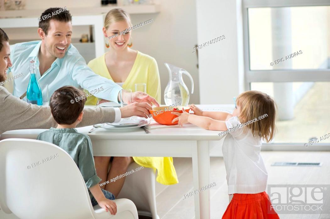 Stock Photo: Little girl serving fruit bowl on dining table.