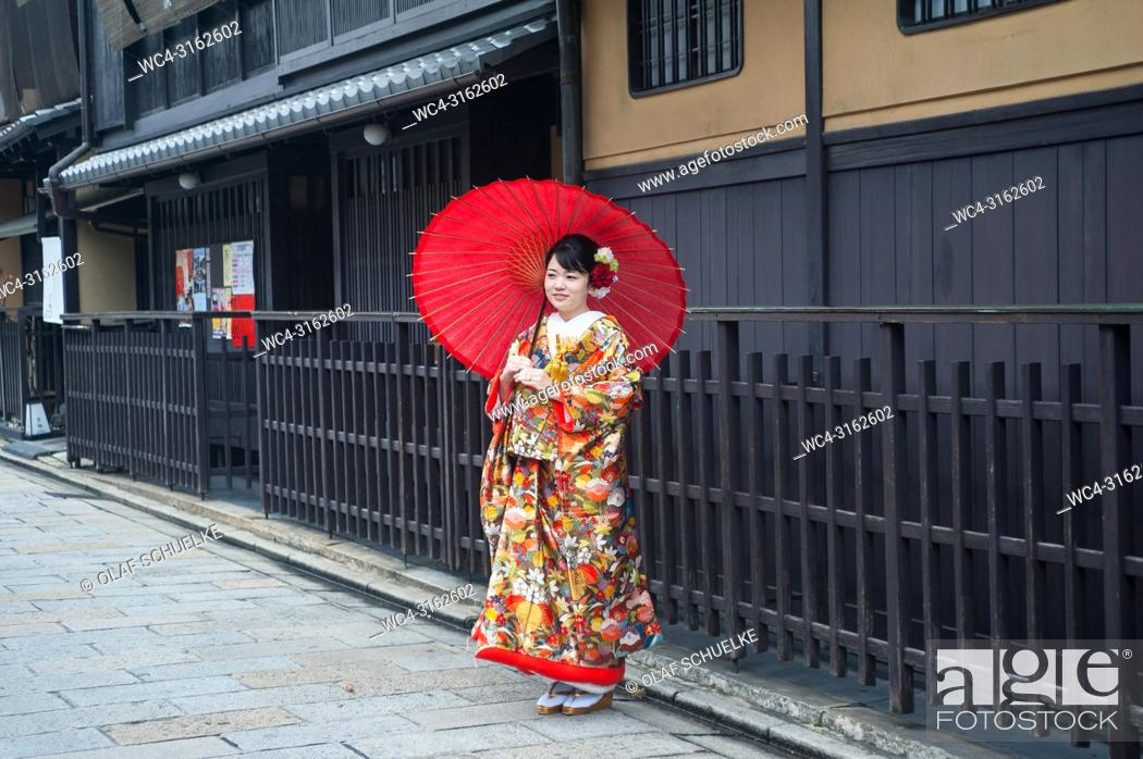 Stock Photo: 25. 12. 2017, Kyoto, Japan, Asia - A young woman wearing a traditional kimono poses for a portrait in the old city of Kyoto.