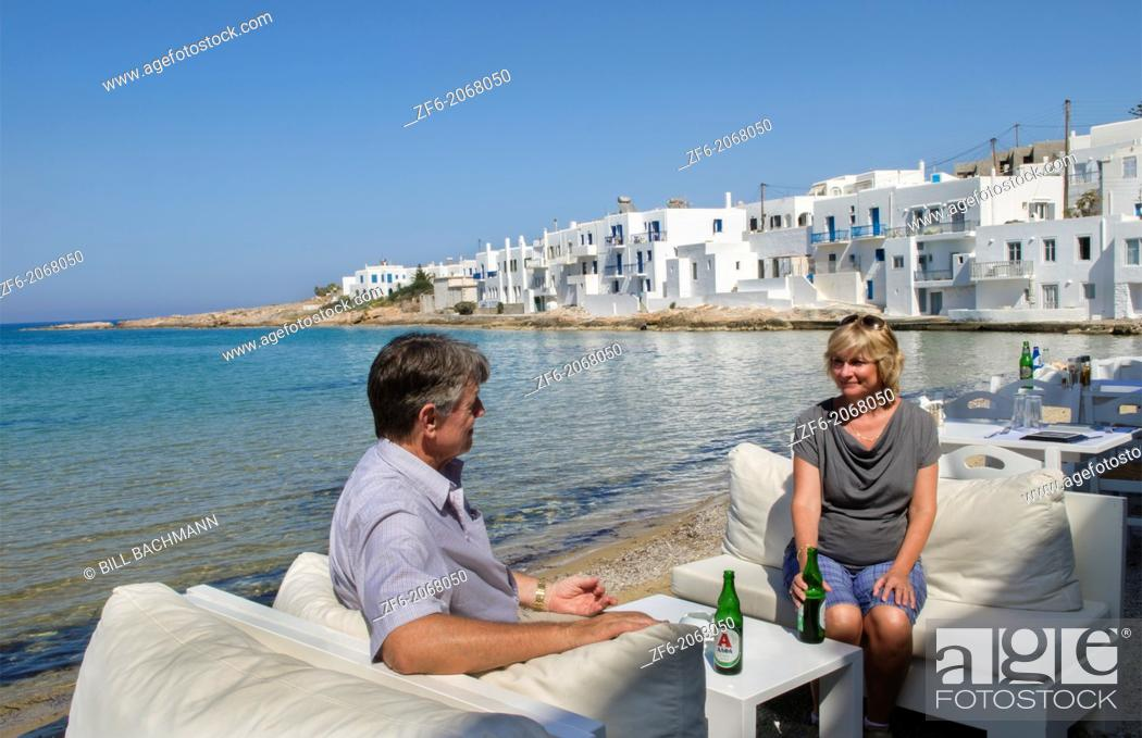 Stock Photo: Greece Paros Cyclades Naousa or Naouusa relax couple with drinks near water 6.