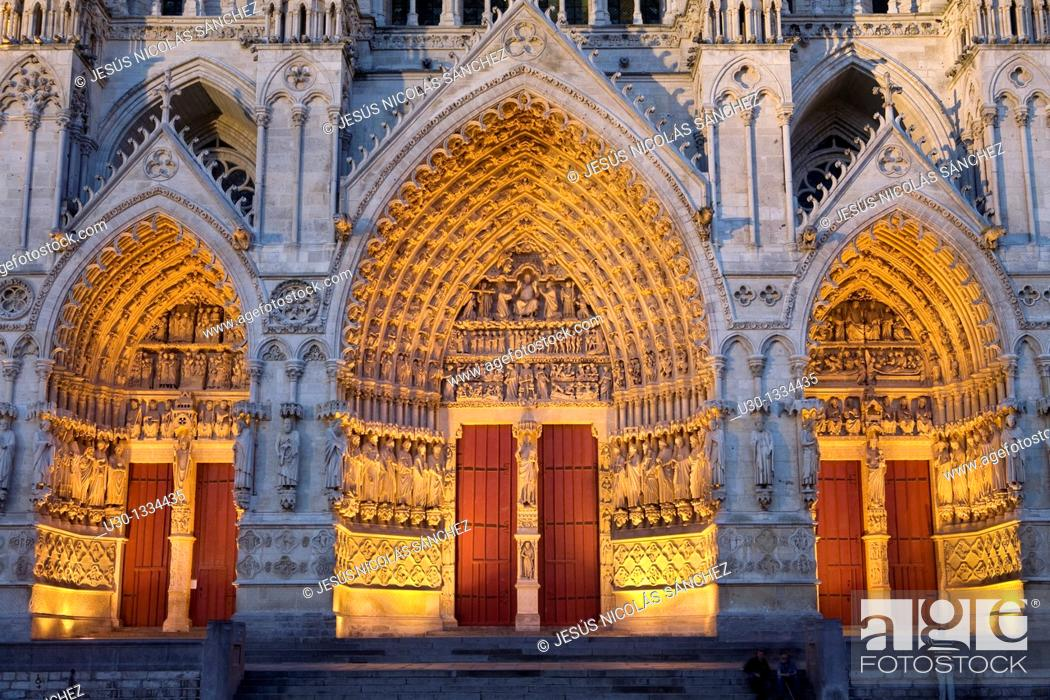 Stock Photo: Night view  Ornate doorway of the Cathedral of Notre Dame, from XIII Century, in Amiens listed as World Heritage by UNESCO  It's the Highest ghotic cathedral of.