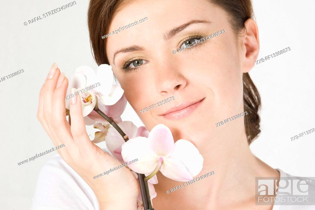 Stock Photo: portrait of woman with orchid.