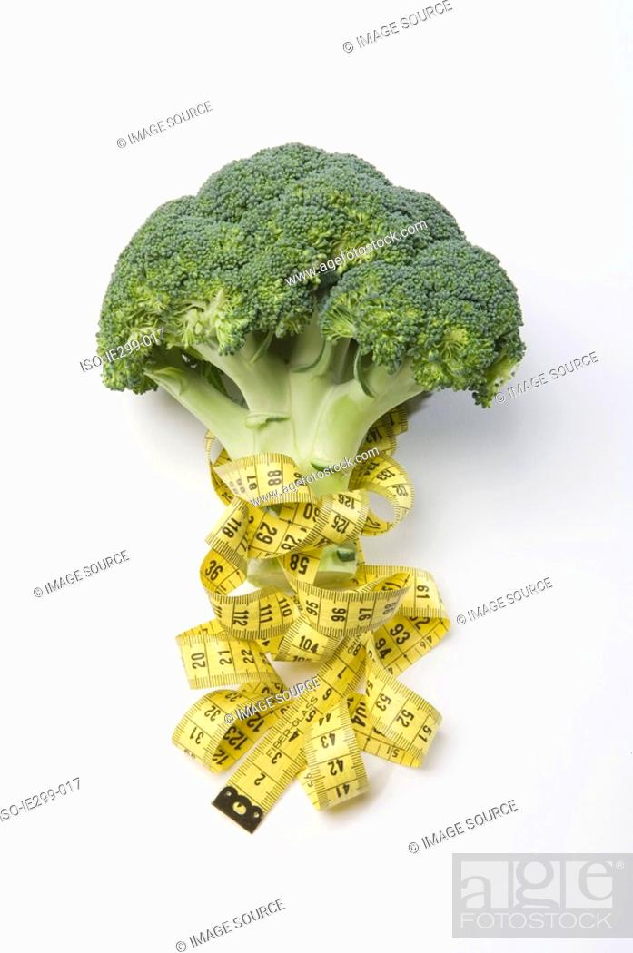 Stock Photo: Broccoli and a tape measure.