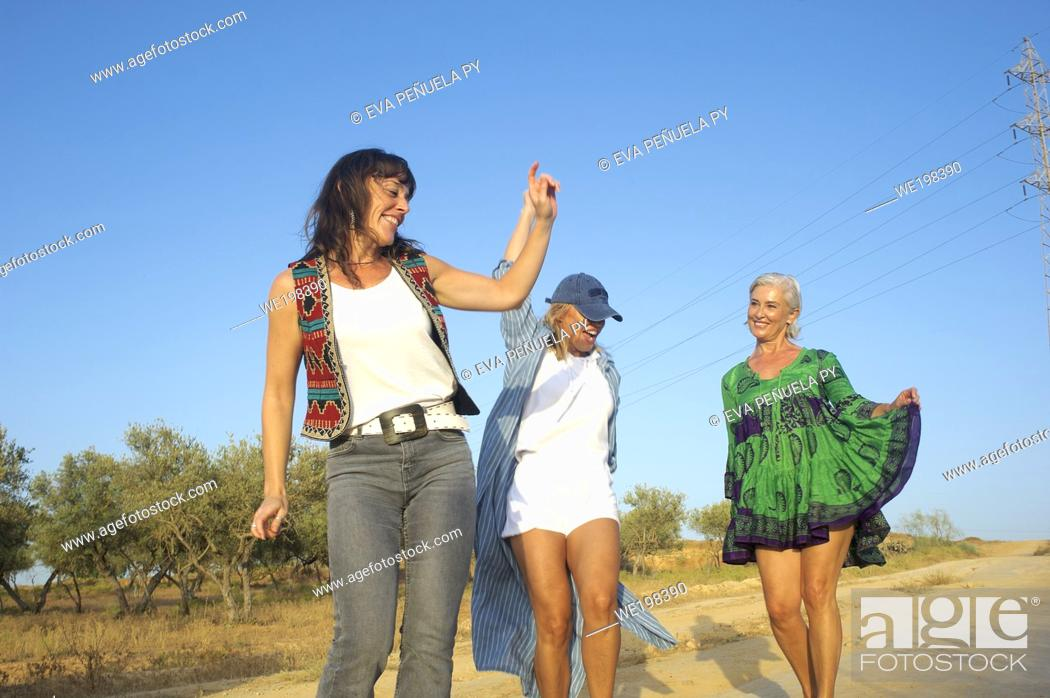 Stock Photo: Trip of three sisters through rural routes by car.