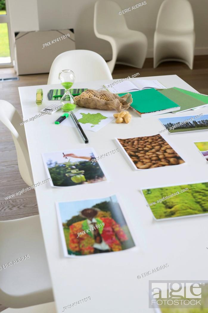 Photo de stock: Ecology sustainable development related photographs on a table.