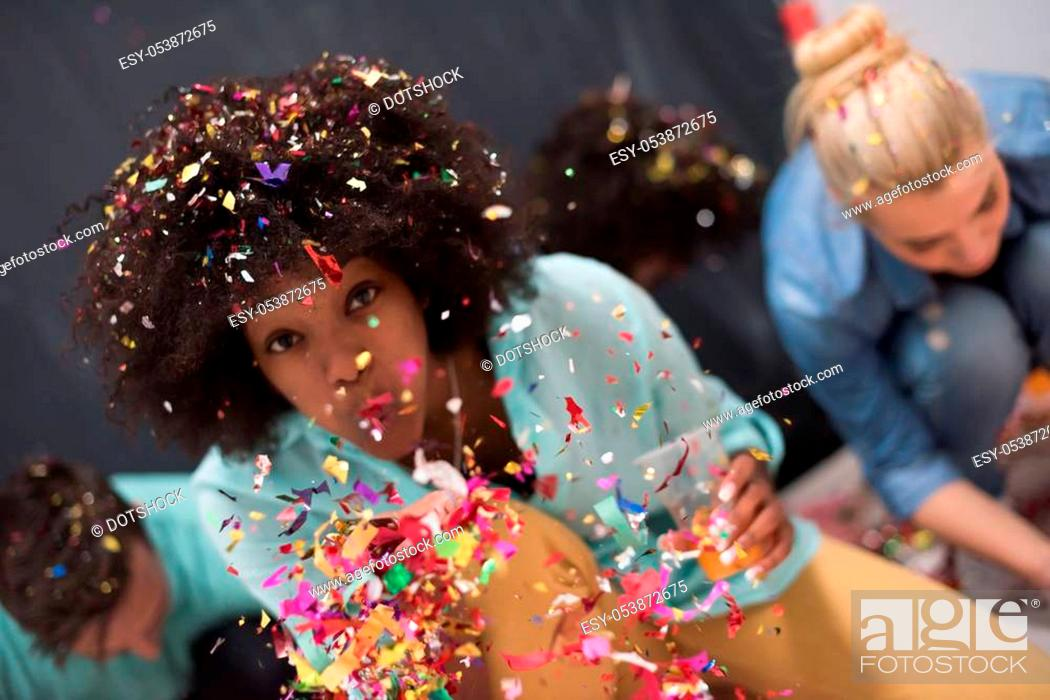 Stock Photo: confetti party Multiethnics group of happy young people celebrating new year eve while dancing and have fun at home.