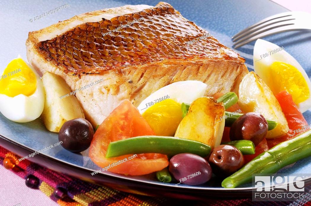 Stock Photo: Grilled fish with hard boiled eggs and vegetables and olives, food.