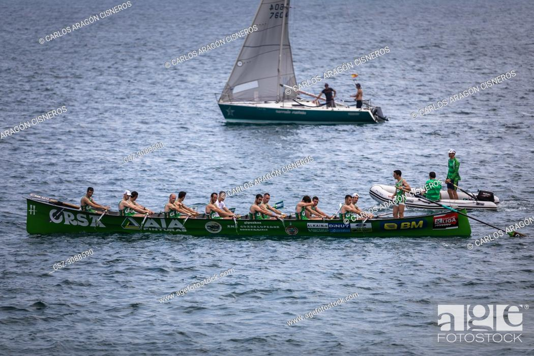 Stock Photo: CASTRO URDIALES, SPAIN - JULY 15, 2018: Competition of boats, regata of trainera, Go Fit Hondarribia boat greets the public in the VI Bandera CaixaBank.