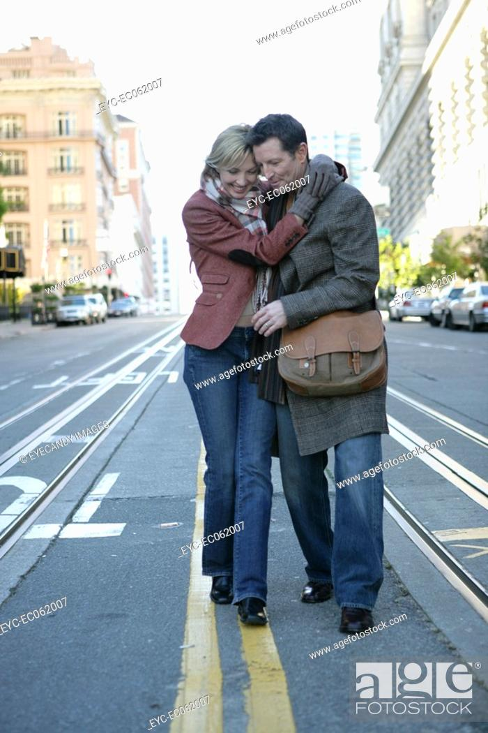 Stock Photo: Mature couple walking in the middle of the street.