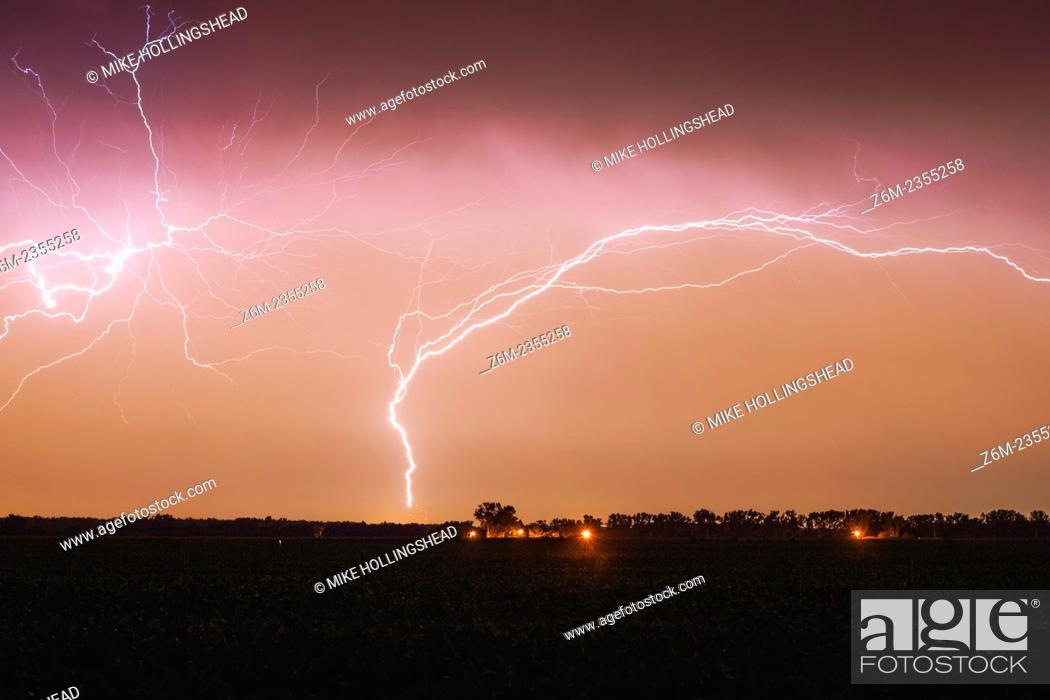 Stock Photo: Lighting leaps upward from an Omaha TV tower.