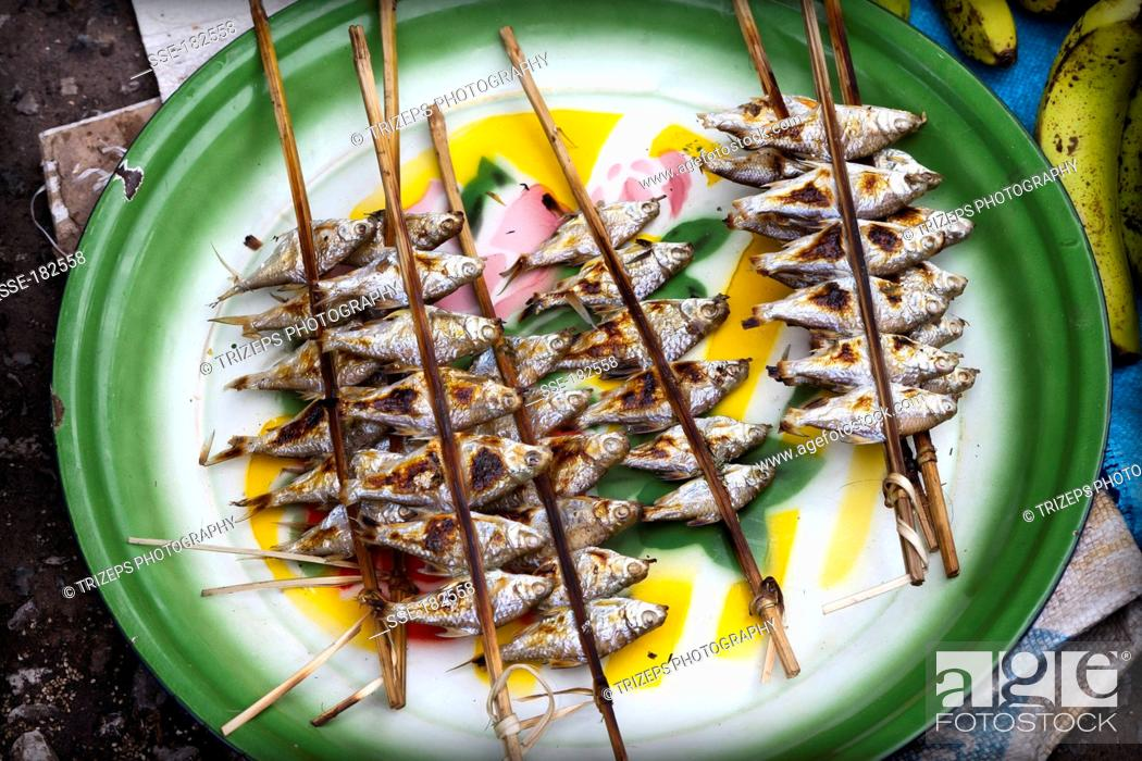 Stock Photo: Small grilled fish on a stall at the market in Luang Prabang, Laos.