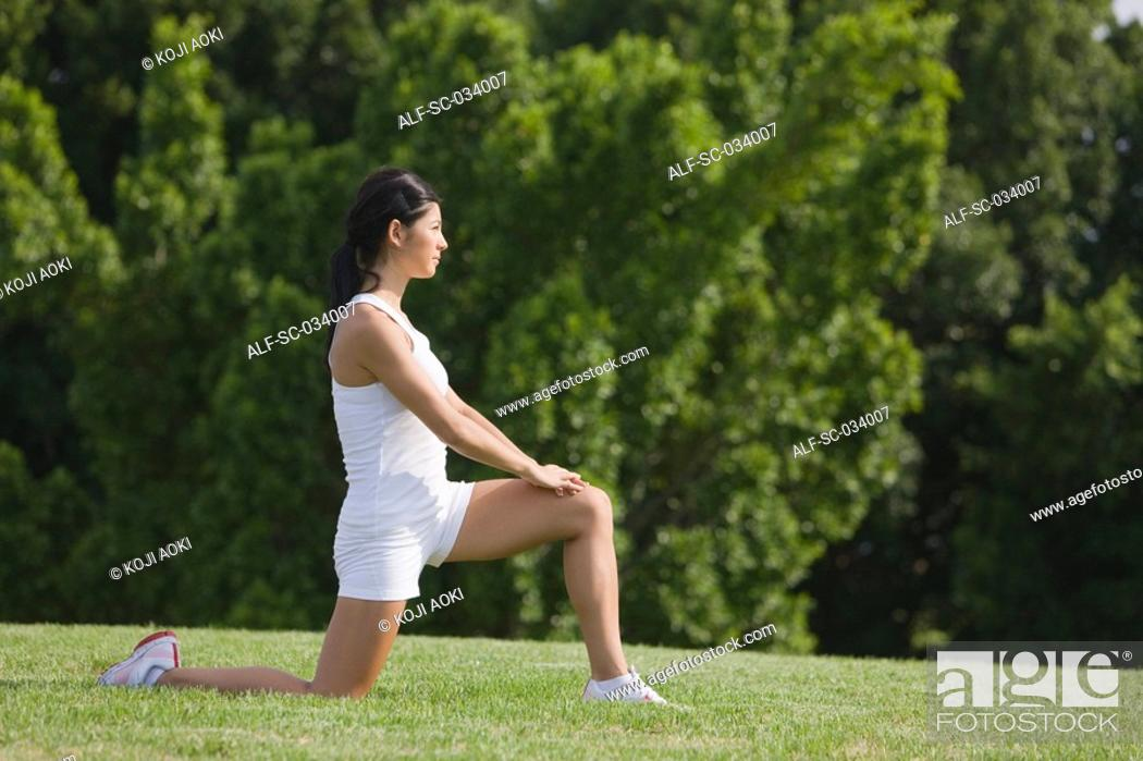 Stock Photo: Young Woman in Low Lunge position of yoga.
