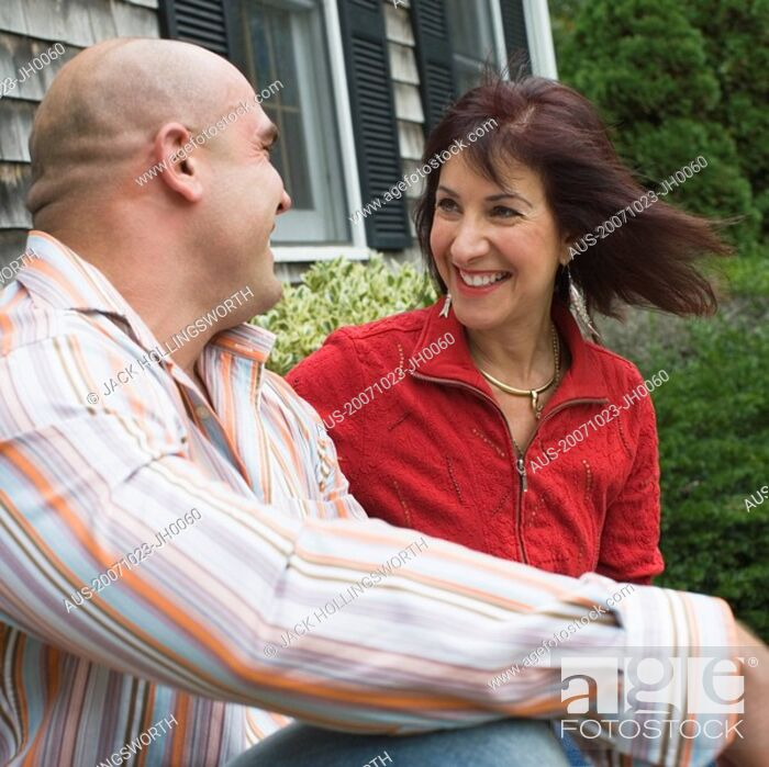 Stock Photo: Side profile of a mid adult man sitting with a mature woman.