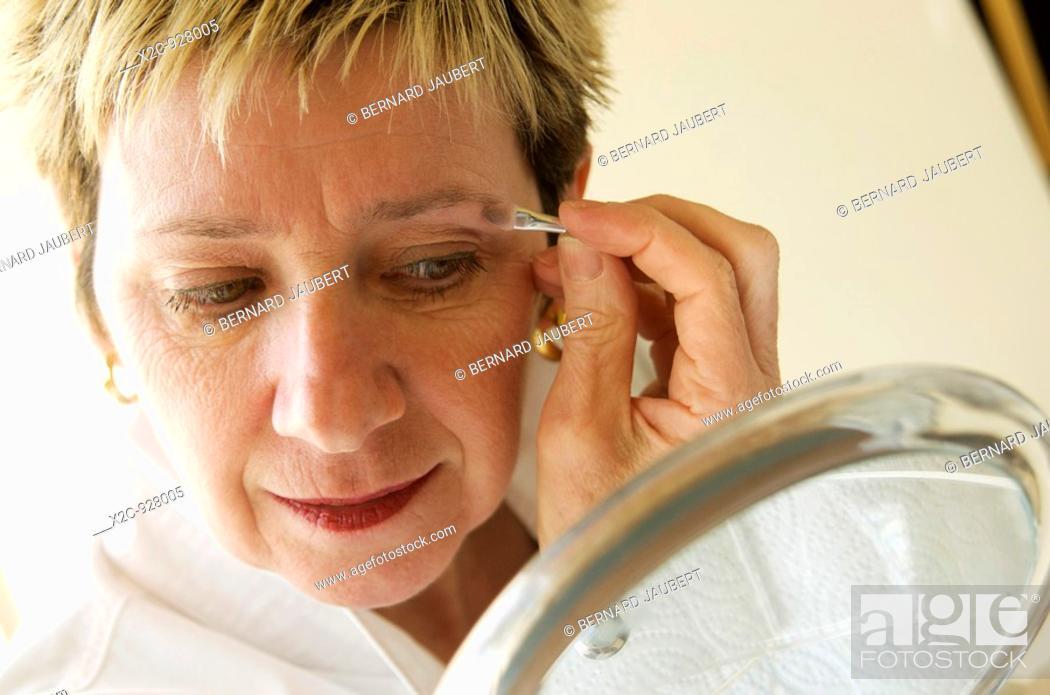 Stock Photo: woman making up itself.