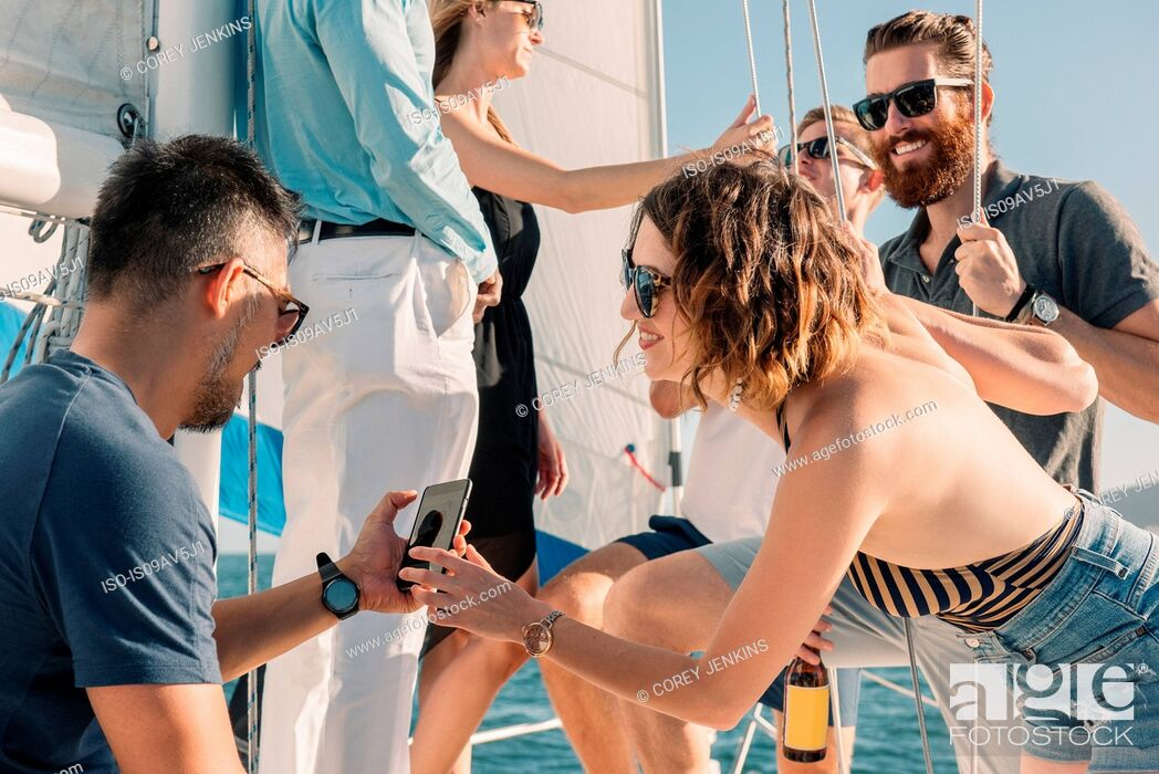 Stock Photo: Friends having fun on sailboat.