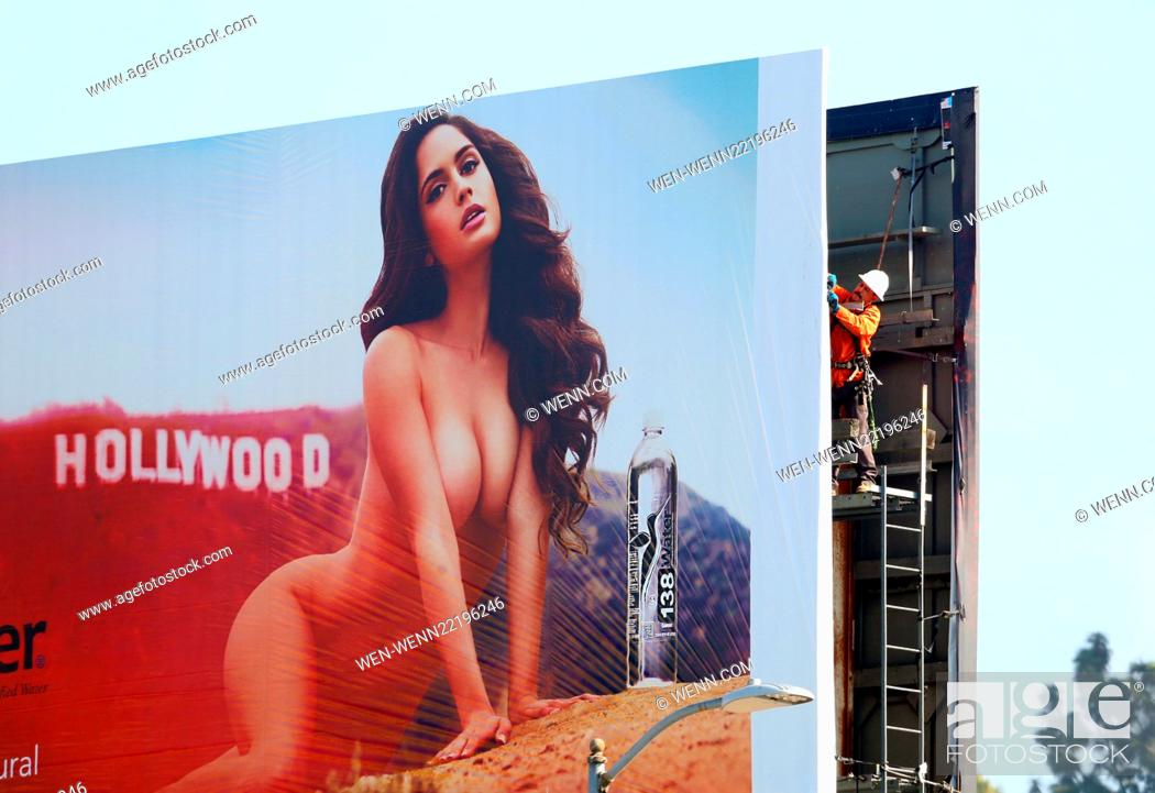 Model Natalia Barulich Appears Naked On A Billboard Being Put Up On
