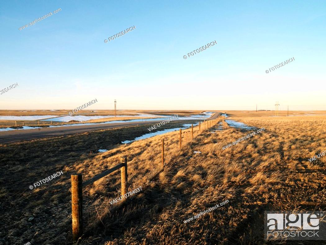 Stock Photo: Road with melted snow in rural setting.