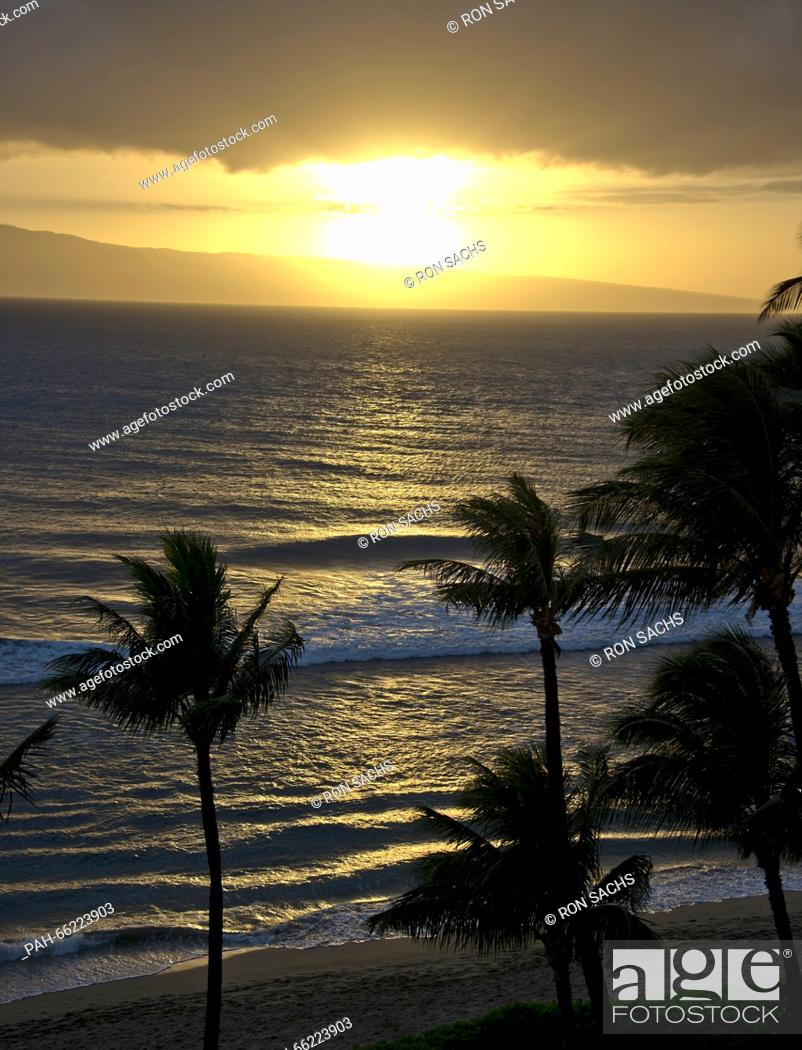 Stock Photo: Sunlight reflects off the Pacific Ocean few moments before sunset from Kaanapali Beach, Maui, Hawaii looking west towards Lanai.