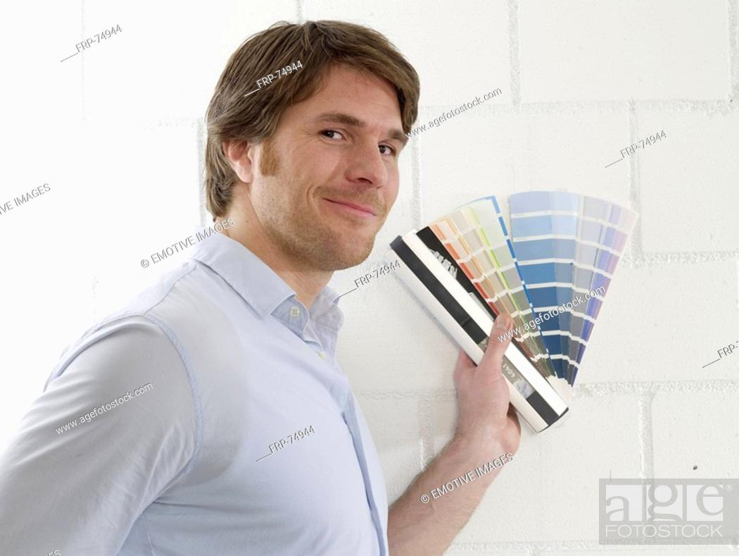 Stock Photo: Man with colour palettes.