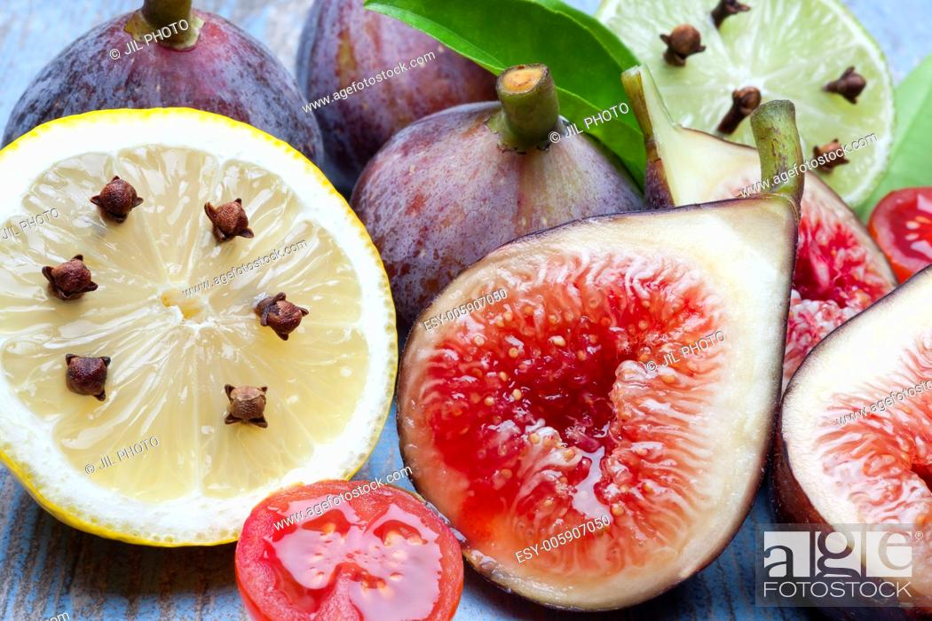 Stock Photo: figs and lemon still life with spices.