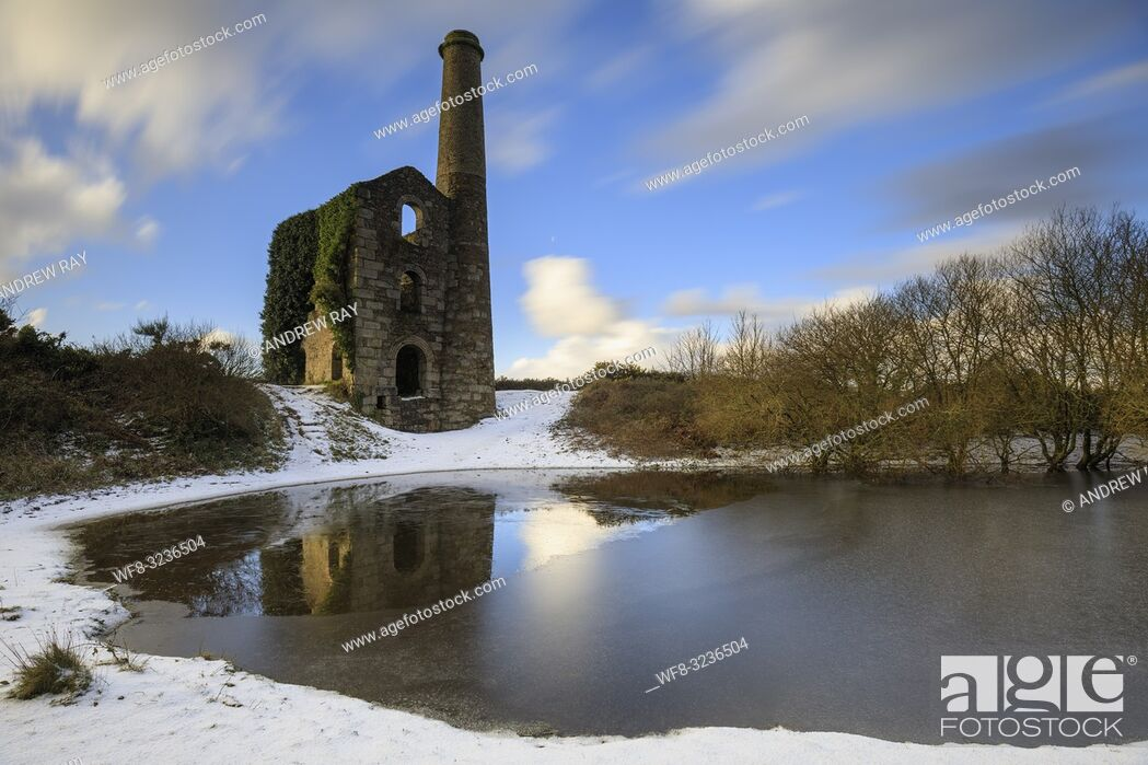 Stock Photo: The Cornish engine house and pool on United Downs captured using a long exposure after a snowfall in early February.