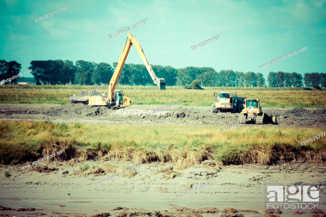 Stock Photo: excavator on new construction site.