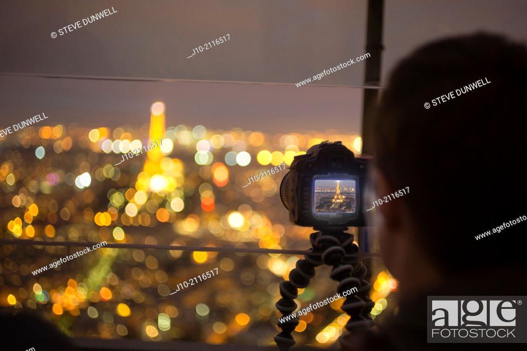 Stock Photo: Tourist photo of Eiffel Tower, night, from Tour Montparnasse, Paris, France.