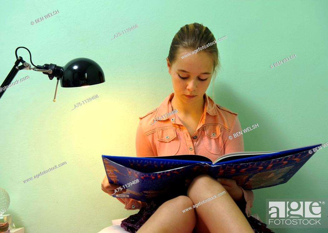 Stock Photo: Girl reading a book.
