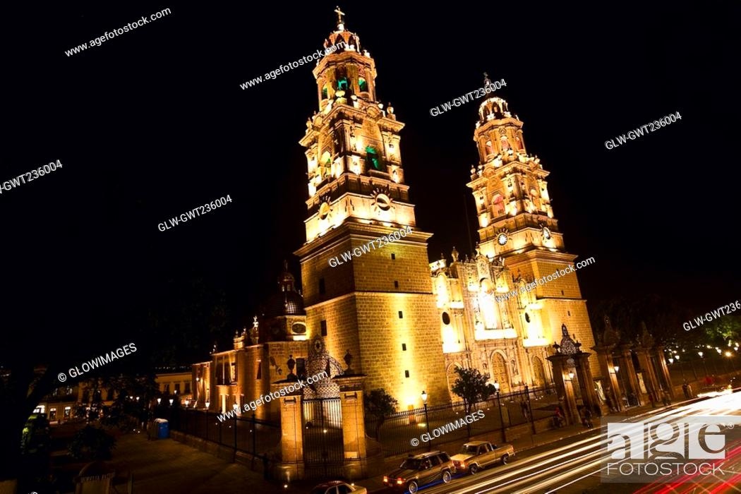 Stock Photo: Low angle view of a cathedral lit up at night, Morelia Cathedral, Morelia, Michoacan State, Mexico.
