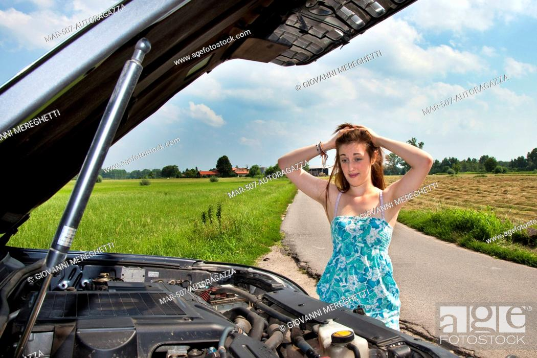 Stock Photo Young Woman With A Broken Down Car