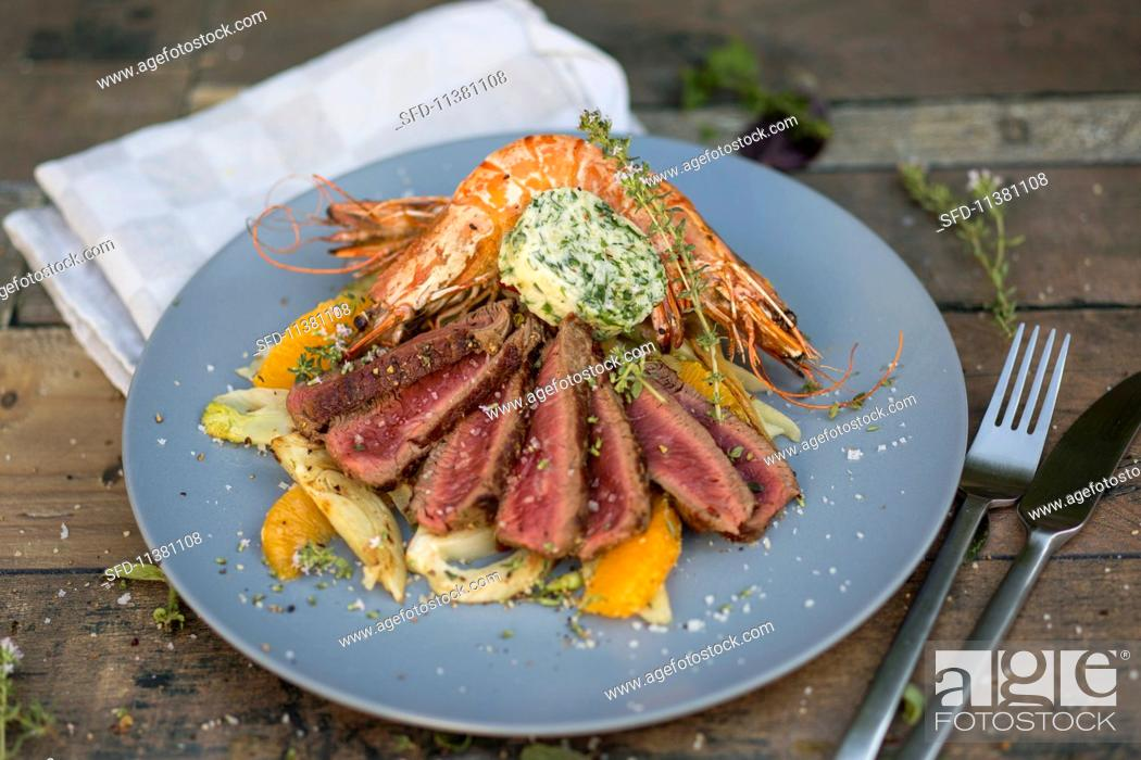 Stock Photo: Surf & Turf with prawns and beef.
