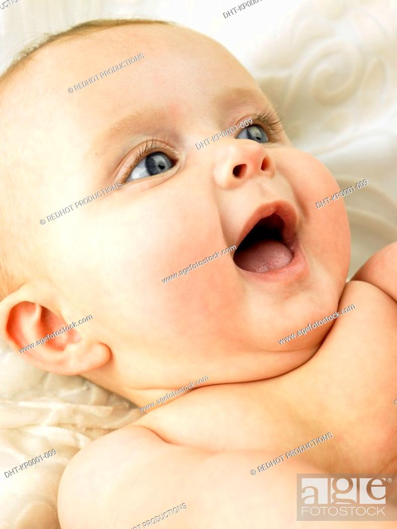 Stock Photo: Baby lying down with mouth open.