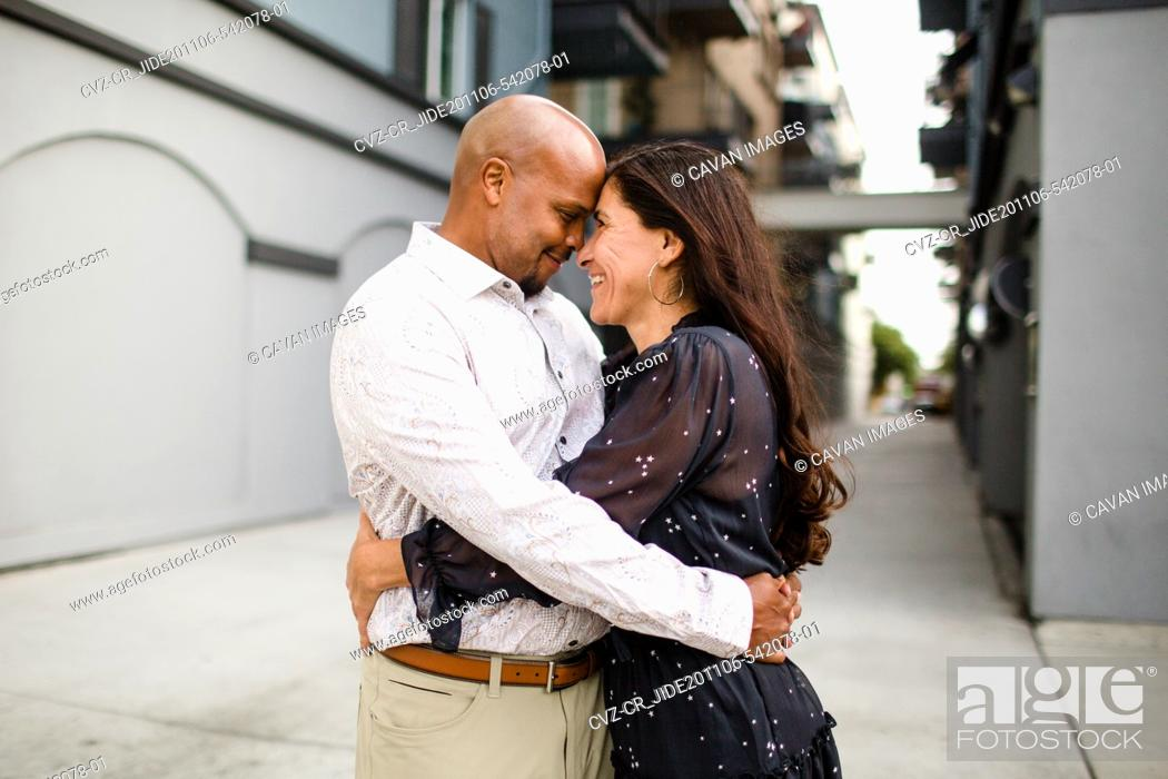 Stock Photo: Late Forties Couple Embracing in Alley in San Diego.
