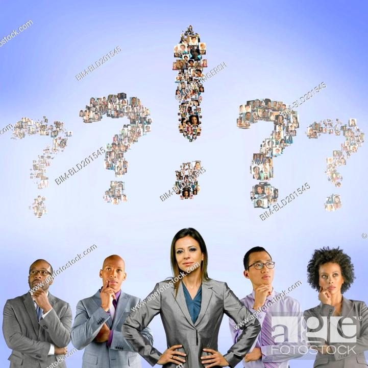 Stock Photo: Business people with question marks above their heads.