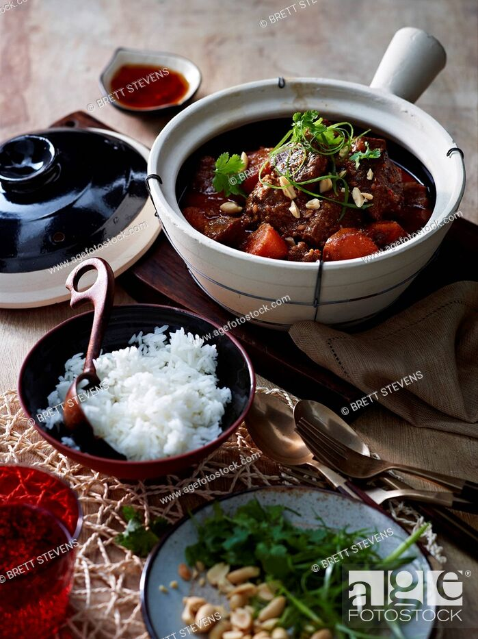 Stock Photo: Table with Thai hot pot served with steamed rice.