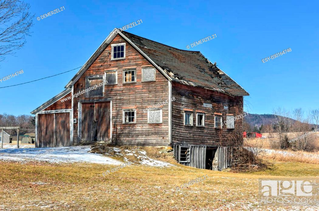 Stock Photo: Abandoned and collapsing farmhouse in Rutland, Vermont in the winter.