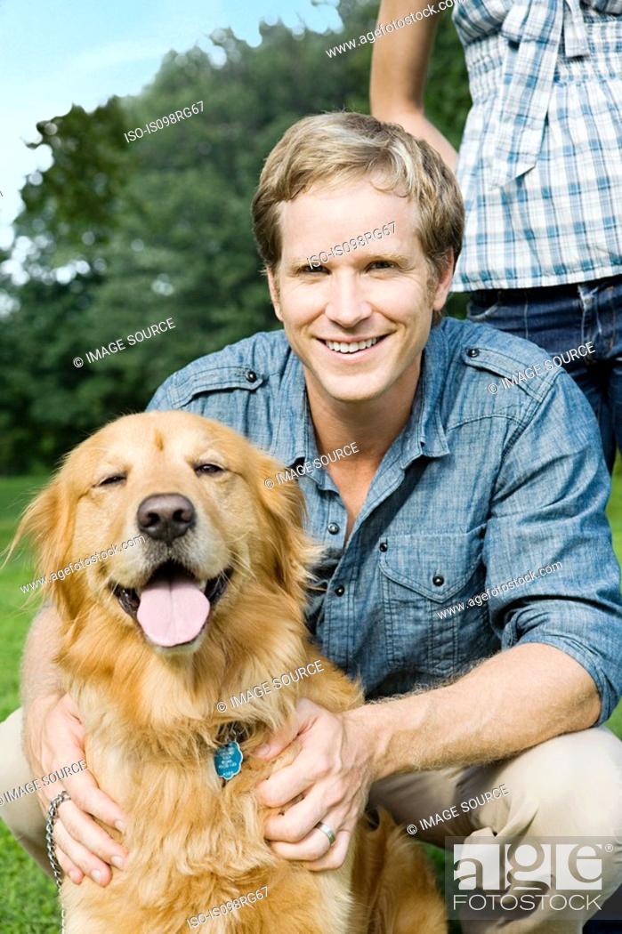 Stock Photo: Man with golden retriever.