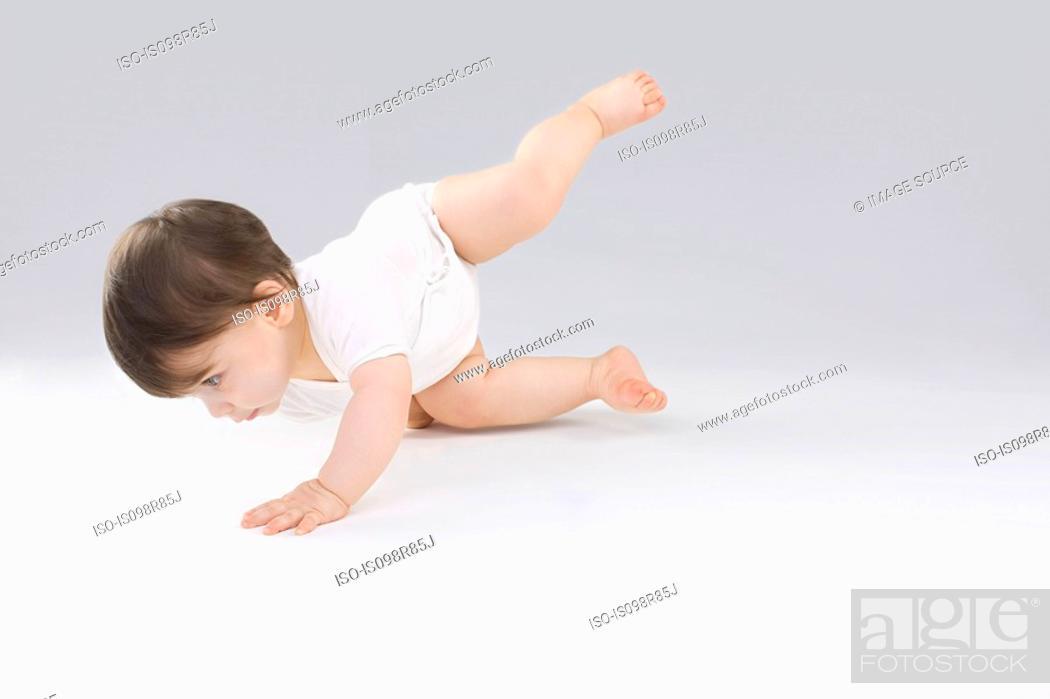 Stock Photo: Baby balancing.